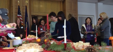 Students are lined up to serve food at the MIFP holiday party